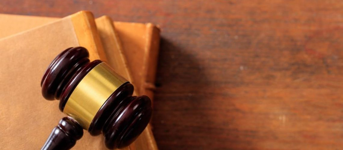 Law gavel on law books, wooden desk, copy space